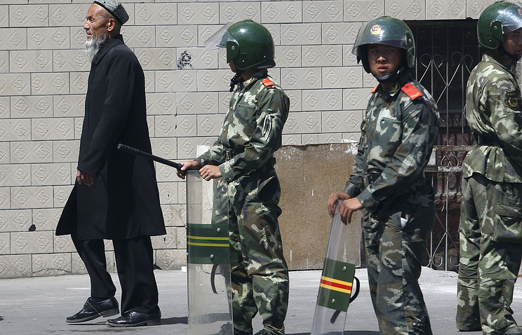 Police officers China's Xinjiang province