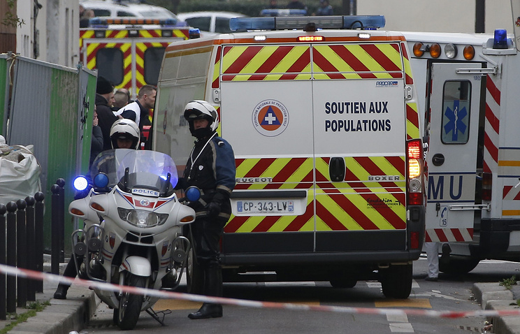 Police near the 'Charly Hebdo' headquarter where a shootout occurred in Paris