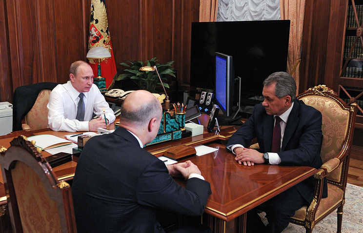Russian President Vladimir Putin at a working meeting with Defense and Finance Ministers, Sergey Shoigu and Anton Siluanov