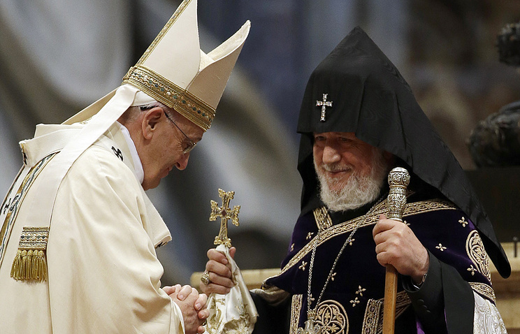 Pope Francis (left) is greeted by the head of Armenia's Orthodox Church Karekin II