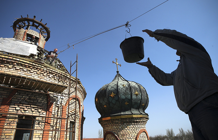 Local citizens repair a church in war-torn east Ukraine