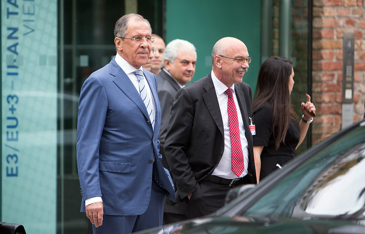 Russian Foreign Minister Sergey Lavrov (L) leaves the Palais Coburg where talks between the E3+3 (France, Germany, UK, China, Russia, US) and Iran continued, in Vienna, Austria
