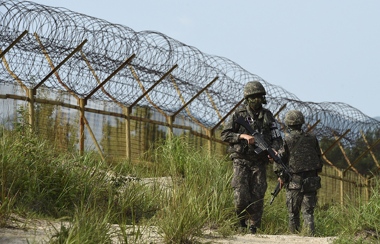 South Korean army soldiers patrol inside the demilitarized zone