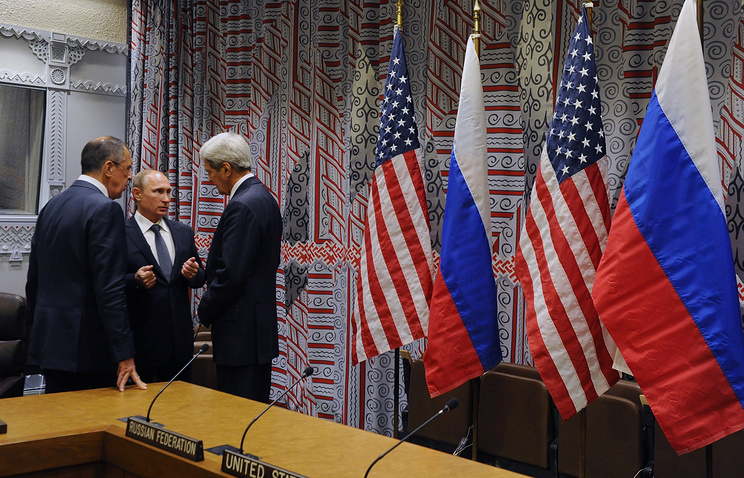 Russia's Foreign Minister Sergei Lavrov, Russia's President Vladimir Putin and US Secretary of State John Kerry talking after Putin's meeting with US President Barack Obama