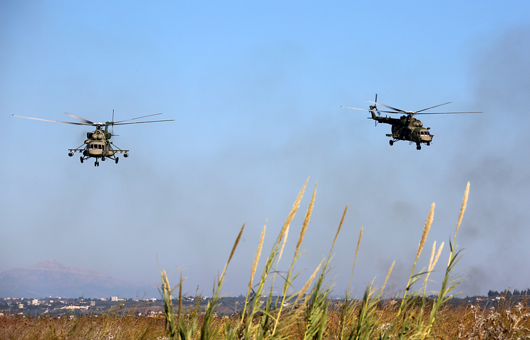 Russia's  combat helicopters at Hmeymim airfield in Syria
