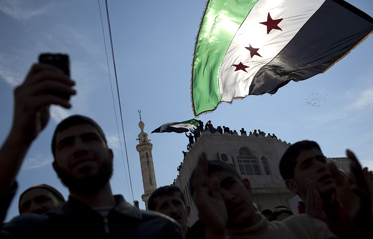 Revolutionary Syrian flags seen during an anti-government protest in a town in northern Syria