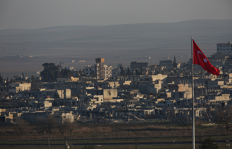 View of the devastated Syrian city of Kobani seen from border town of Suruc, Turkey