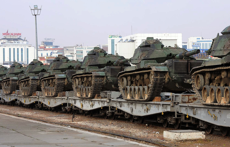 Turkish army tanks are stationed at a train station after their arrival from western Turkey, in Gaziantep