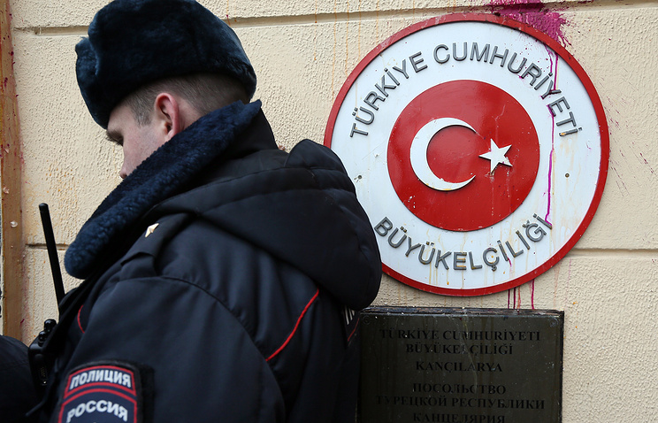 A police officer outside the embassy of Turkey in Moscow