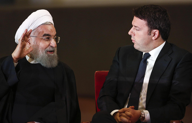 President of the Islamic Republic of Iran Hassan Rouhani (L) meets Italian Prime Minister Matteo Renzi