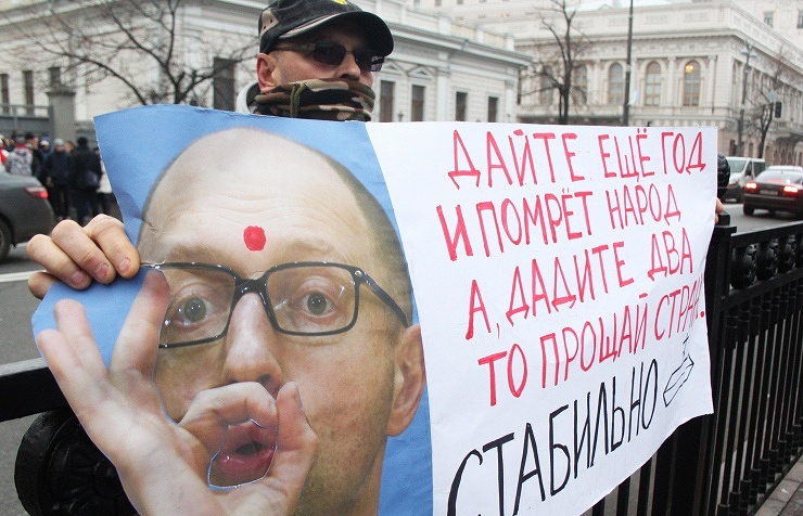 A Ukrainian protester with an anti-government poster