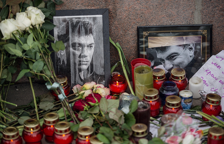 Flowers and candles left at a portrait of Boris Nemtsov in central Moscow