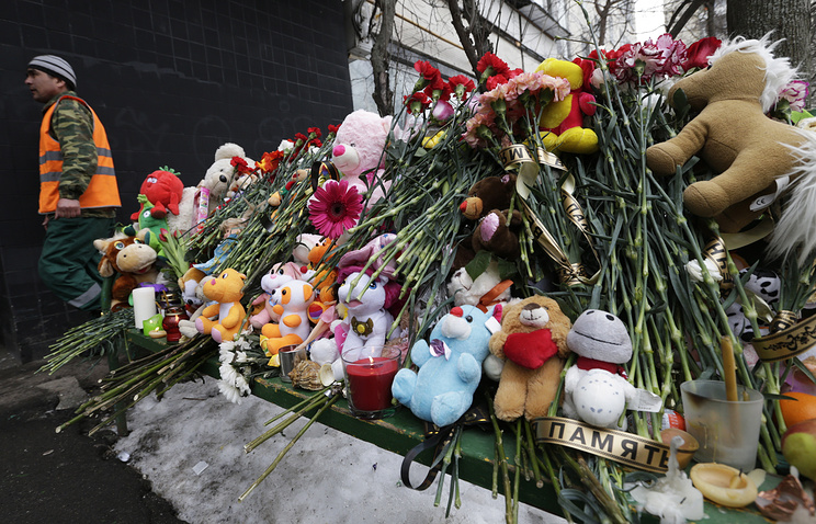 Floral and toy tributes left by mourners outside an apartment block in Moscow where a four-year-old girl was murdered