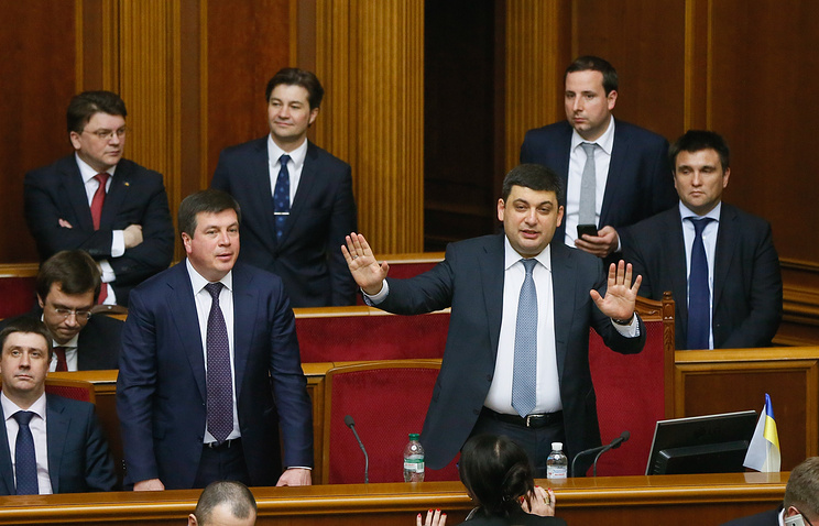 Newly elected Ukrainian Prime Minister Volodymyr Groysman with the ministers of the new government of Ukraine during a session of Ukrainian Parliament in Kiev