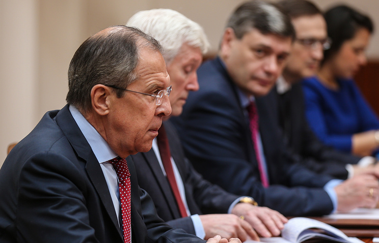 Russian Foreign Minister Sergey Lavrov (front)