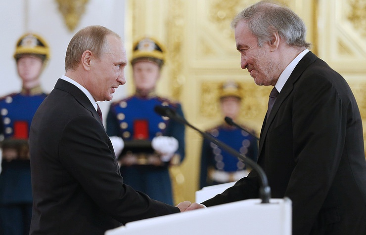 Russian President Vladimir Putin and conductor, artistic director of the Mariinsky Theatre Valery Gergiev at the ceremony