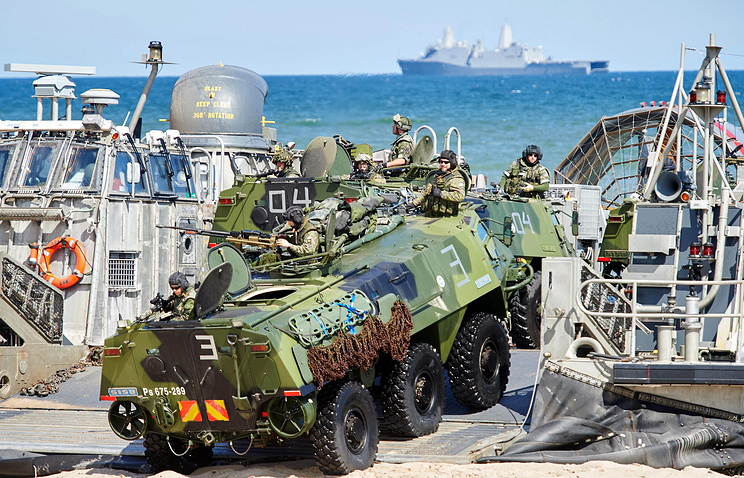 Finnish army armored vehicles on board of the US Army hovercraft, 2015