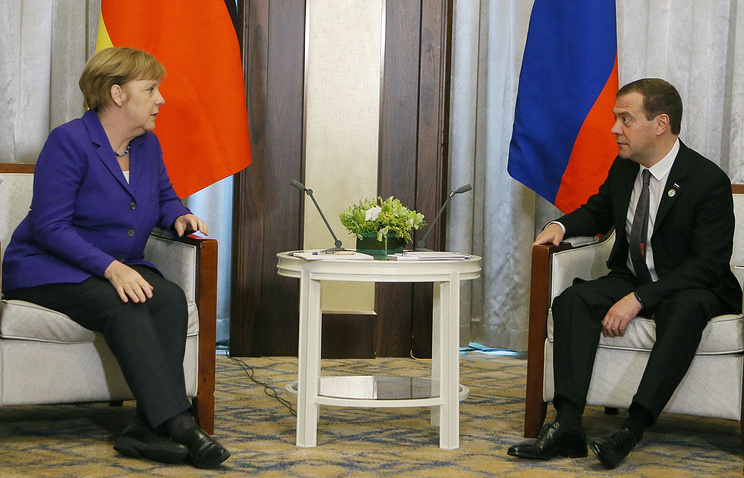 Angela Merkel and Dmitry Medvedev