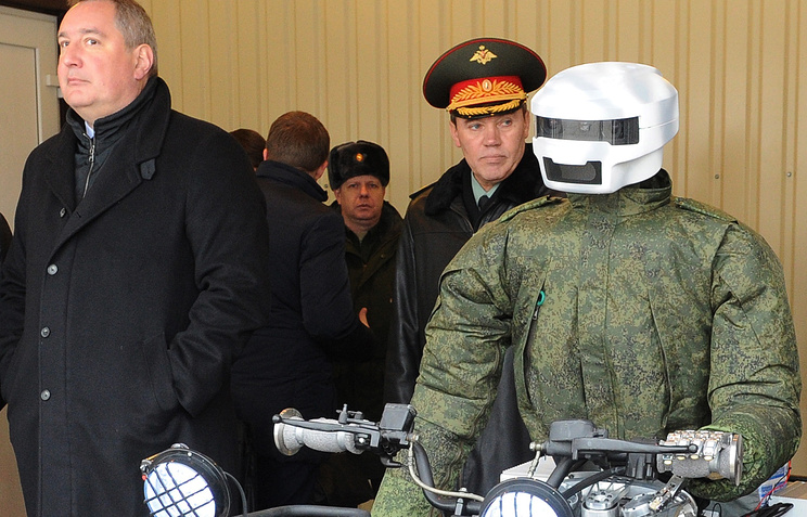 Russia's deputy prime minister Dmitry Rogozin and first deputy defense minister Valery Gerasimov durin the robot's demonstration in the Research Institute for Precision Machine Engineering, 2015
