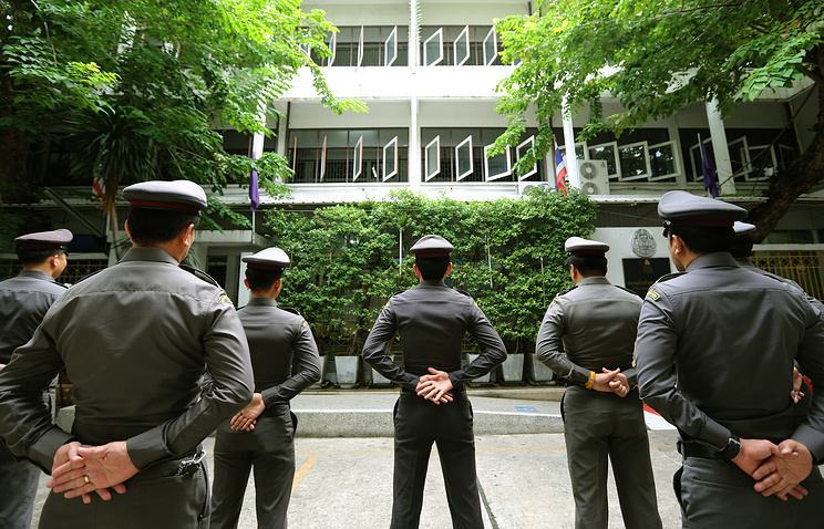 Thai police officers in front of the detention center in Bangkok