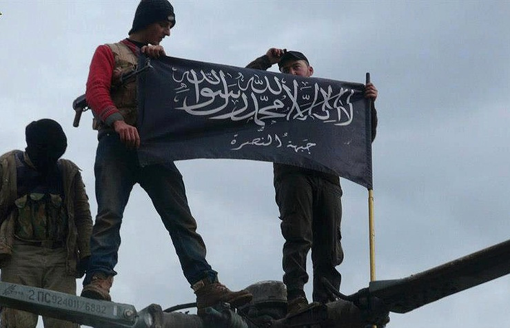 Rebels from Jabhat al-Nusra waving their flag