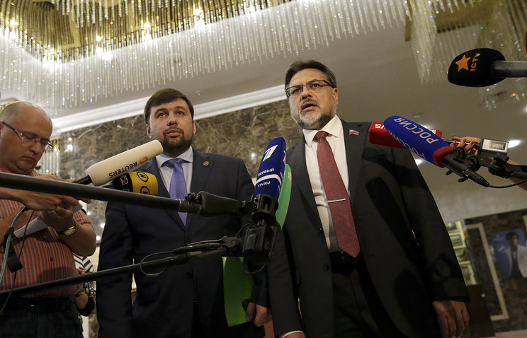 Denis Pushilin, chief negotiator of the self-proclaimed Donetsk People's Republic and Vladislav Deinego, representative of the self-proclaimed Luhansk People's Republic