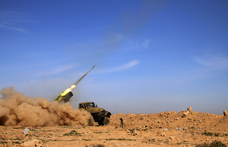 Syrian army fire a rocket at Islamic State group positions in the province of Raqqa