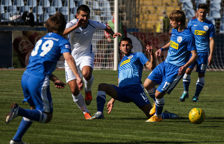 SKChF Sevastopol's and Tavria 's players fight for the ball in their Crimean Cup football match