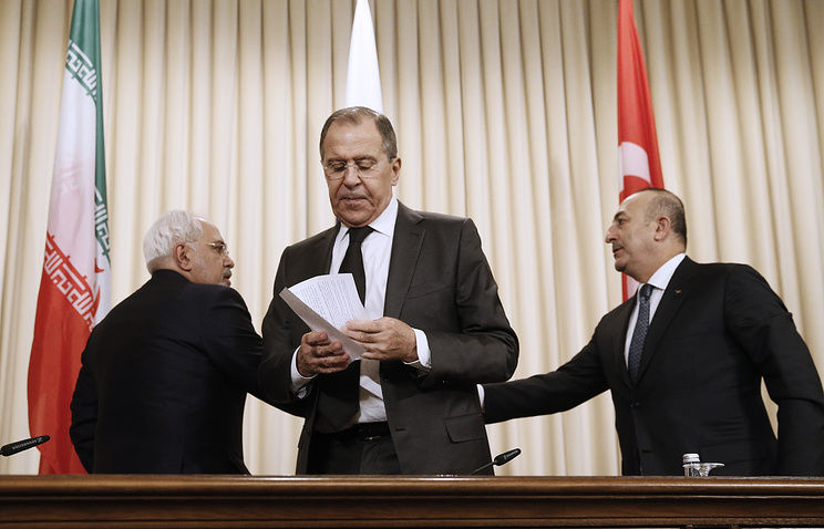 Iran's Foreign Minister Mohammad Javad Zarif, Russia's Foreign Minister Sergei Lavrov, and Turkey's Foreign Minister Mevlut Cavusoglu at Syria settlement talks