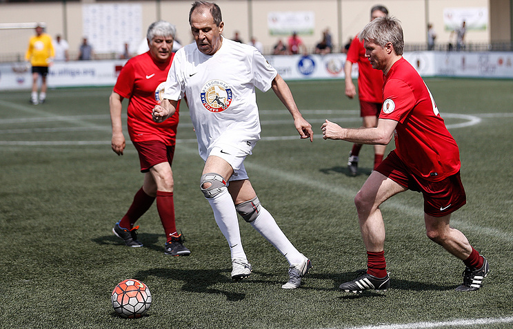 Russian Foreign Minister Sergei Lavrov (center) playing a football match with other Russian officials