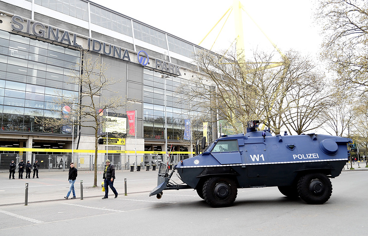 A armored track of German police secure the stadium ahead of the UEFA Champions League quarter final, first leg soccer match between Borussia Dortmund and AS Monaco in Dortmund, Germany