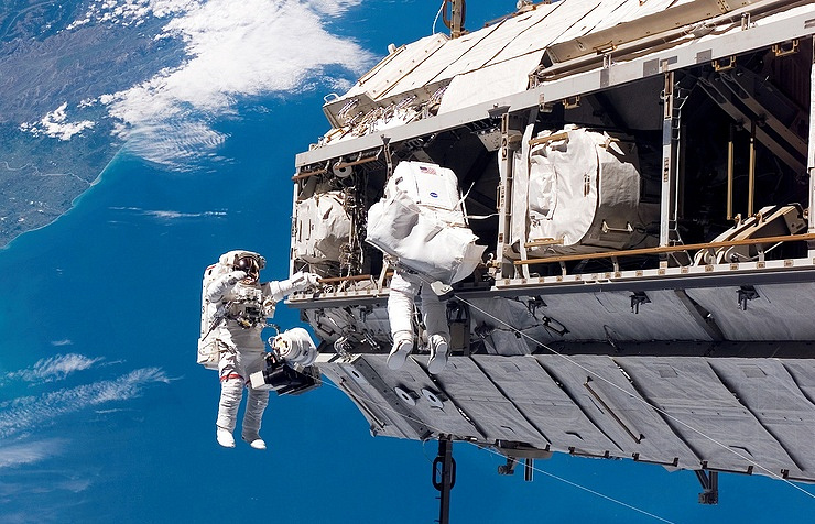 USA astronauts prepare for spacewalk outside International Space Station