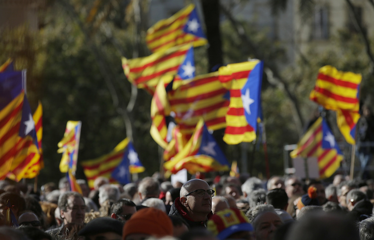 "People hold ""estelada"" or pro-independence flags in Barcelona, Spain"