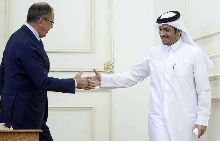 Russia's Foreign Minister Sergei Lavrov and Qatar's Foreign Minister Mohammed bin Abdulrahman Al Thani