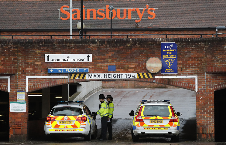 Police officers seen after finding an abandoned car near to where Sergei Skripal and his companion were found critically ill