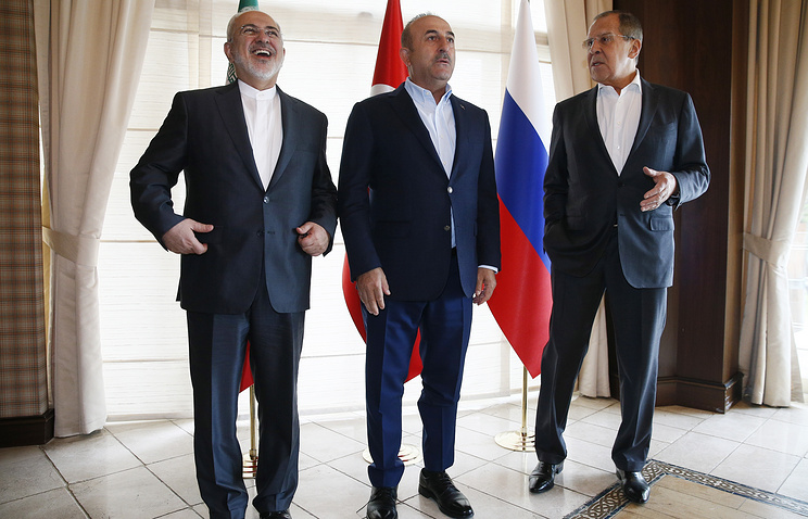 Iranian, Turkish and Russian Foreign Ministers Mohammad Javad Zarif, Mevlut Cavusoglu and Sergey Lavrov