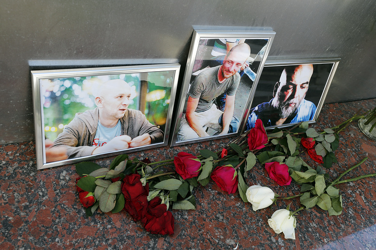 Photographs of Russian journalists Alexander Rastroguyev, Kirill Radchenko and Orkhan Dzhemal