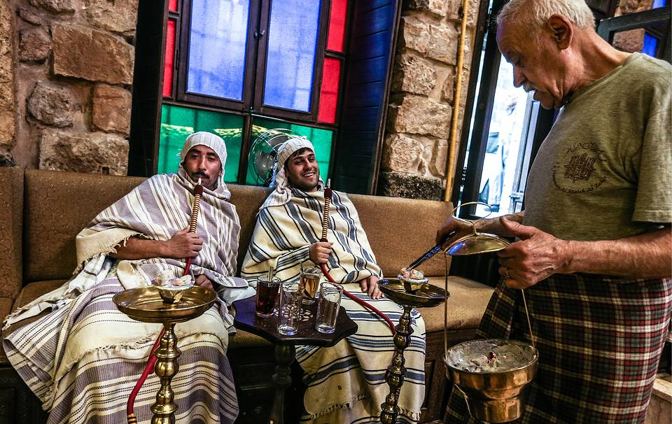 Men smoking hookah in a hammam steambath in Damascus, April 10, 2016 Valery Sharifulin/TASS